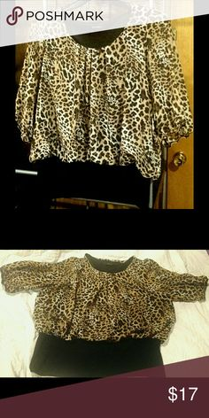 """Leopard Print Sheer Blouson Top NWOT Blouson style leopard print top with stretchy black band at the bottom. This top is sheer but has a black lining underneath. The 3/4 length sleeves are sheer with elastic at the bottom of the sleeves.  This top is new without tags. It was purchased from a local boutique and the brand is """"Color Swatch"""". The size is 2XL but it fits small, more like an XL or 1X. Measurements are listed below.   Length 25 inches Length to Black Band 20 inches Sleeves 16…"""