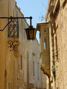 Strategically placed lamps illuminate a Medieval era passageway. http://www.maltapackageholidays.co.uk/ (V)