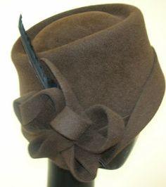 214c7192c561e I started blocking this hat on a slanted block