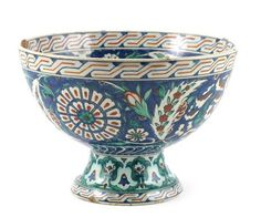 A Cantagalli Iznik pedestal bowl, painted with flowers and foliage in colours on a white ground p