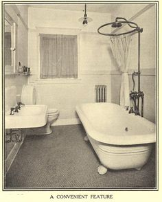 """A 1912 Bathroom (called """"A convenient feature""""!) was indeed a new addition to most homes after 1900. The claw-footed tubs were very comfortable, and the tiled floors and enameled woodwork were planned with a view to sanitary design. A single light bulb with a reflector shade illuminates the room. The wainscot may have been tile, or a popular feature of dense plaster scored to simulate tile, and then painted with shiny paint. This 'faux-tile' finish was found in both kitchens and bathrooms of"""