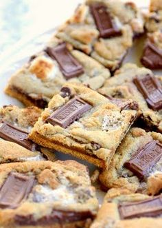 S'mores Cookies | S'mores Cookies Yield: 3 dozen Ingredients 11 Tablespoons unsalted butter, softened 1 cup brown sugar, packed ½ cup granulated sugar 2 large eggs 1 teaspoon vanilla 1 teaspoon baking soda ½ teaspoon sea salt (optional) 1 teaspoon cinnamon 2 ½ cups flour 1/2 cup semi-sweet chocolate chips 1 cup mini marshmallows 3 regular sized Hershey's bars, broken into pieces 1-2 packages graham crackers, broken into squares