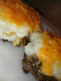Mini shepherds pies  By. LA SImms Catering Chefs. .2017 arr.. Season beef patties with your desired seasons place on foil for easy clean up. .  Delicious adds. Tomato sauce or kernel corn to your beef.  Mix mashed  potatoes put on top lastly add cheddar  cheese  Bake 375
