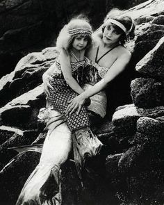 "Production still of ""Mermaid Land"" in the lost film A Daughter of the Gods (1916, dir. Herbert Brenon). Annette Kellerman as Anita (daughter of the Gods) and Violet Horner as Zarrah (child)."