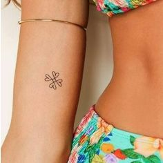 Four leaf shamrock tattoo