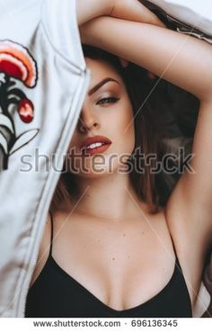 Portrait of beautiful woman with makeup in fashion clothes