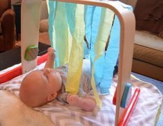 Discover how daily floortime play like this activity with streamers helps your baby learn.