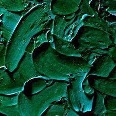 Dikke klodders groene verf