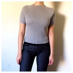 Grey Short Sleeve Turtle Neck Sweater Ribbed short turtle neck top with short sleeves. 100% cotton. Worn couple of times. Soft and thick. No rips. No stains. The Limited Sweaters Cowl & Turtlenecks