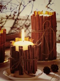 Candles with cinnamon  #candles #centerpiece use small twigs instead do cinnamon and maybe evergreen boughs on larger candles with large pine cones and or small pumpkin goudrs