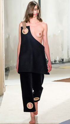 JACQUEMUS FALL RTW 2015 Praying with proportion, this giant eyelets are a dramatic aesthetic decision that questions functionality and aesthetic values.