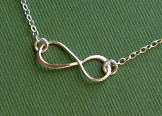 Small asymmetrical sterling silver infinity by jersey608jewelry, $20.00. WANT