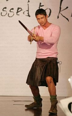 Gerard Butler, a real man can pull off pink and a skirt. :)
