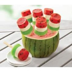 Watermelon Pops -surprize your taste buds!  Layers of raspberry, cream cheese and lime look like watermelon slices with chocolate chip 'seeds' in these tasty frozen pops.""