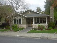 Great curb appeal will make your house the envy of the block. Sage Green House, Green House Color, Property Design, Rental Property, Craftsman Exterior, Craftsman Homes, Craftsman Bungalows, Foundation Planting, Landscape Plans