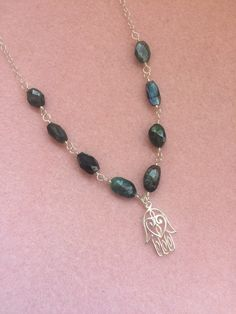 A personal favorite from my Etsy shop https://www.etsy.com/listing/398810761/green-labradorite-sterling-silver-and