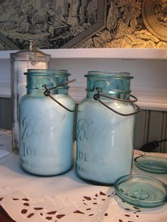 Here, they've filled jars with bath salts and use/display in the bathroom. You could also fill them with cotton balls, and a smaller one with Q-tips....Great idea!