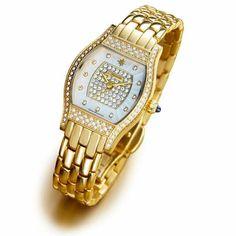 Reloj de oro de mujer Femenine: 11 diamantes marcando las horas, 146 auténticos cristales de Swarovski iluminando dial y bisel, cabujón de zafiro y oro.