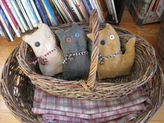 These three adorable primitive kittens measure 7 each. They have been grunged, painted and sanded and are rag stuffed. Each one wears a homespun collar with a rusty bell attached with a rusty pin. These kittens will be perfect for your collection of primitive dolls as well as for enhancing your primitive decor. Pattern by Cave Creek Primitives *not for children*