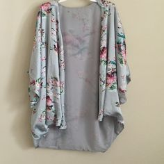 Spring Floral Kimono Short sleeved loose and flowy kimono! 100% polyester. Fits both small and medium. Tops Tunics