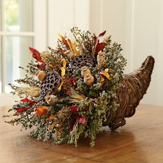 Williams Sonoma offers elegant decor for fall, including Thanksgiving centerpieces. Find fall decor that adds autumnal color to any home. Fall Flowers, Dried Flowers, Fall Floral Arrangements, Thanksgiving Centerpieces, Thanksgiving Table, Thanksgiving Cornucopia, Autumn Decorating, Fall Home Decor, Fall Wreaths