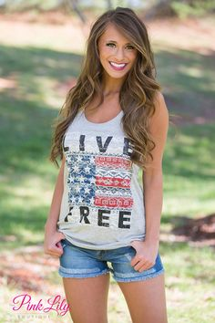 """Show off your American Pride with this bestselling """"Live Free"""" tank top! Racerback tank made of thin, lightweight material with one-inch straps to keep you cool this summer!"""