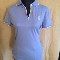 Blue Ralph Lauren polo shirt Beautiful sky blue Ralph Lauren sporty polo short sleeve!!! So sporty chic!! I love this and this is too small on me too  Ralph Lauren Tops