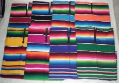 "Mexican Serape Poncho Pancho by CMFA. $15.75. One size fits all (Ships Daily, Arrives in 2-3 days)  Get it in time for Halloween.. Measures 36"" in width by 38"" in length. Available in Blue, Black, Green, Orange, Pink, Red, Turquoise, and Yellow. Great for Halloween Costume.  Item ships USPS Priority Mail. Arrives 2-4 days after order is placed.. Machine Washable.  100% acrylic. 100% authentic from Mexico."