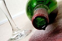 How to Remove Red Wine Stains From Fabric:  Immediately - blot - then combine 1tsp laundry soap & 1 cup hydrogen peroxide - soak clean sponge - squeeze - gently blot stain.