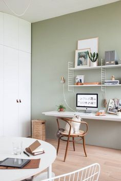 Light home office with green wall styled by Holly Marder