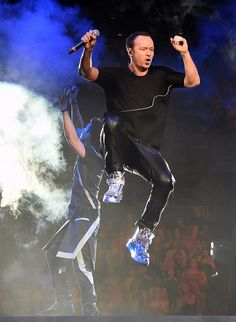 Singer Donnie Wahlberg of New Kids on the Block leaps in the air as he and singer Jordan Knight (L) perform during the kickoff of The Main Event tour at the Mandalay Bay Events Center on May 1, 2015 in Las Vegas, Nevada.