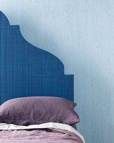 It may shine like raw silk, but this soft-blue wall with subtle stripes is produced by a pad of steel wool drawn through an iridescent glaze.
