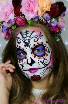 Sugar Skull face painting design. ✨ Perfect for kids and adults. Both will always look gorgeous !! Have you painted a Sugar Skull? Watch the full tutorial on my YouTube Channel: International Face Painting School
