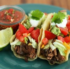 "Shredded Beef Tacos,"" These loaded shredded beef tacos are definitely at the top of my list of favorite foods.  This recipe for shredded beef tacos yields perfectly tender, wonderfully seasoned and flavorful beef."""