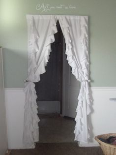 Love the idea of a curtain in an open doorway.  DIY Anthropologie Ruffled Curtains