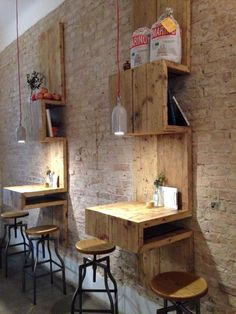 Silo Coffee in Berlin has innovative plywood shelves and tables, industrial stools and ceramic pendants.  A version of this shelving could be used to make a stylish cannabis dispensary. www.dispensarydesignstudio.com