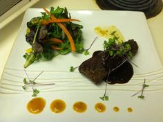 Braised short rib with port wine demi, duo of mango-papaya glaze and minted ginger preserve with baby greens