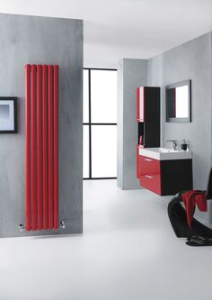 Get Racy with the red revive designer radiator.  This eye-catching red radiator is sure to create a statement in any room.  Use it to contrast with a minimalist design scheme or go all out to co-ordinate with the domino shower panel, the choice is yours.