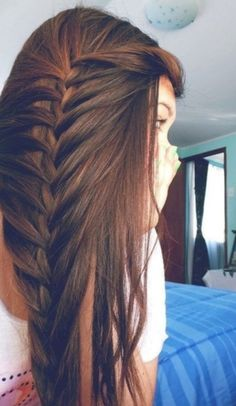 Brown hair loosely braided down the side