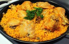 Puerto Rican Arroz con Pollo  In Puerto Rico they make it by combining rice and chicken in a caldero (cast aluminum pot), they season it with famous sofrito, a sautéed mixture of onions, green peppers, garlic and other spices.