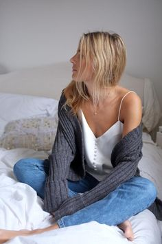 30 Chic No Bra Outfits to Try Now - White camisole, cozy knit cardigan, and vintage denim