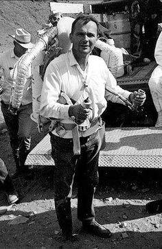 Gene Shoemaker (1928-1997) donning a Bell rocket belt while training astronauts. Shoemaker was a geologist with a particular interest in asteroids and meteors and their craters, and one of the pioneers of planetary science. A possible candidate for an Apollo mission, he was ruled out on health grounds. Along with astronomer wife Carolyn and their friend David Levy, he was co-discoverer of a comet that crashed into Jupiter. After his death Lunar Prospector took some of his ashes to the Moon.