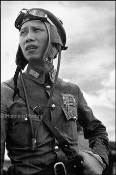 (by Robert Capa). A Chinese pilot. Capa was a Hungarian war photographer and photojournalist who covered five different wars: the Spanish Civil War, the Second Sino-Japanese War, World War II across Europe, the 1948 Arab-Israeli War, and the First Indochina War.