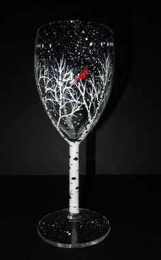 Small (7) white wine glass, hand painted by me with my original cardinal design. If the actual shipping cost is less than I have charged, I will
