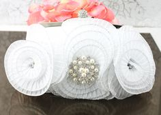 "Wedding Clutch Wedding Purse White Satin by goddessdesignsgems, $59.00 ""So Fabulous"" This purse is so beautiful, fun and flirty it showcases a trio of pleated rosettes in a high quality satin with rhinestone accents. Clutch is embellished with a gorgeous crystal & pearl brooch."""