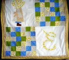 Holly Hobby applique on patchwork baby quilt.  Found at www.threadeddoxie.com