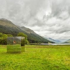 Mirrored cabin installed in Scottish glen  by Angus Ritchie and Daniel Tyler