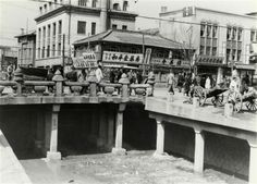 Seoul: Gwangtong Bridge (1953년 청계천 광통교) across Cheonggyecheon, 1953