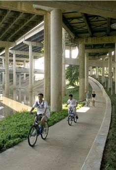 I like the way these elevated roads make motor vehicles do more climbing than humans powering their own vehicles while also providing shelter for the people riding bikes. | Rebuilding Infrastructure