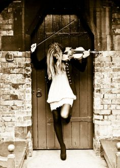 A violinist in a doorway
